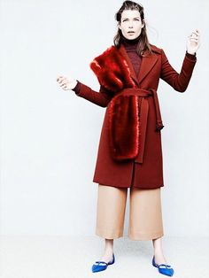 J.Crew fur stole tucked into a red coat. @thecoveteur