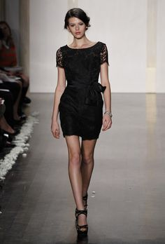 Noir by Lazaro - Fall 2012. Style NZ3232, short black Alencon lace sheath bridesmaid dress with a bateau neckline, cap sleeves, and tie sash, Noir by Lazaro
