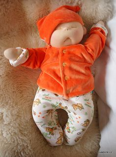 This baby doll is a prototype, so you can buy it for special price. 18 inch/ 45 cm soft sculpted baby doll. Big enough for preemie clothes, but the doll have own clothes - romper, t-shirt, hat, diaper - everything in rainbow-blue harmony. THE CLOTHES ARE REVERSIBLE, SO IT IS LIKE YOU HAVE TWO SETS OF CLOTHES INSTEAD OF ONE.    The arms have plastic joints, so they are movable, legs are sewn on. The doll is stuffedwith clean poly fibre and weighted with glas granulate. He is very cudly an...