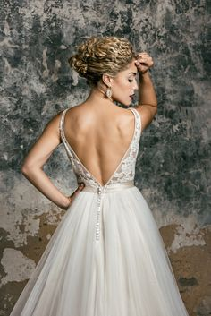 Backless is in. To find your perfect backless wedding dress book an appointment online today! http://carriesbridalcollection.com/product/wedding-dress-appointment/ #BacklessWeddingDresses #BookAnAppointment #WeddingDresses #CarriesBridalCollection