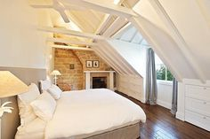 Loft bedroom... the exposed brick wall alone is enough to sell this room!