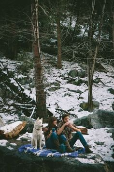 This is gonna be us someday. Sitting on a cloth, sorrounded by snow, drinking hot tea, with our dog ♥