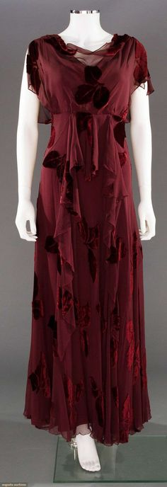 CUT VELVET EVENING GOWN, 1930s Cranberry leaves cut to chiffon, bias cut w/ matching silk slip                                                                                                                                                      More