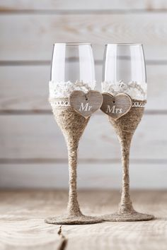 Wedding Toasting Glasses Rustic Toasting Flutes Wedding Champagne Flutes Bride and Groom Wedding Glasses with Twine and Burlap. by InesesWeddingGallery on Etsy https://www.etsy.com/listing/209244922/wedding-toasting-glasses-rustic-toasting