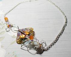 Magical Moth made by lampwork artist from Russia.  All Sterling Silver, with Aquamarine, Carnelian, Rainbow Moonstone, Amethyst, Lemon Quartz, Whiskey Quartz.