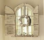 Repinned from google.com.   Like this window mirror w/shutters.