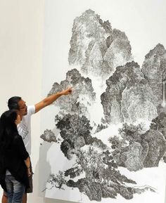 "Artist Chen Chun-Hao uses a nail gun to replicate traditional Chinese landscape paintings of masters Fan Kuan and Guo Xi. Each ""mosquito nail"" creates a dot on the canvas, and when viewing the dots as a whole you see mountains, forests, streams,  and other elements."