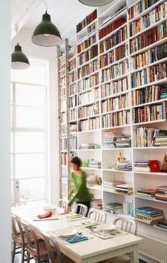 Wall of shelves - love bookcases in dining rooms!