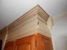 For that dead space above the kitchen cabinets. Match color with paint or stain.