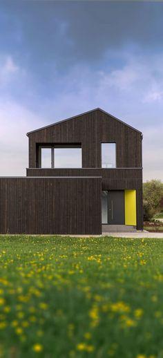 Das Architekturbüro KU Architekten entwarf auf einem etwa 600 Quadratmeter großen Grundstück ein energieeffizientes Holzhaus für eine Familie.