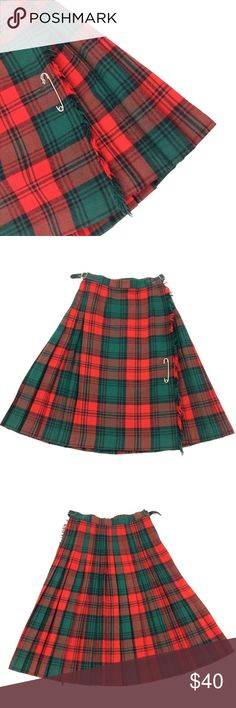 Authentic Scotsman 100% Wool Kilt Skirt This is an Authentic wool scotsman kilt skirt. It is green, red, and black plaid. It has two buckle adjustments on the side and a kilt pin on the front. It is made in england and a sz 10. Falls below the knee. Scotsman Skirts Midi