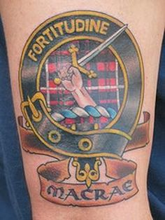 A family crest tattoo done elegantly with a tag of MACRAE.