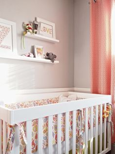 love this baby girl nursery. shelves above the crib.