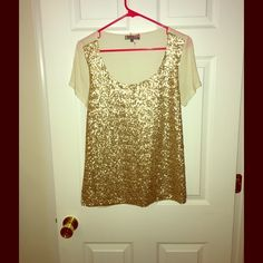 Gold Sequined Jeans By Buffalo Top Great top for fun occasions. Small gold sequins down the front. Size medium. I cut off the inside tag so am unsure of material but I would assume cotton and modal. Jeans By Buffalo Tops