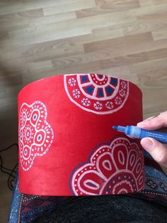 This old beige canvas lamp shade was just screaming out for some attention and a bit more color I decided to get on it! I love being able to give a plain Jane l… Decorate Lampshade, Lampshade Redo, Fabric Lampshade, Lampshades, Lampshade Ideas, Acrylic Paint Pens, White Acrylic Paint, Red Paint, Hula Hoop
