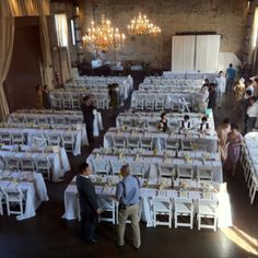 Another great example of a banquet setting where configuration is of utmost importance. This space is designed to accommodate hundreds of guests while providing easy access for serving staff. Here, chiavari chairs would be the standard option however, these white folding chairs not only accommodate the hosts needs, but they provide an excellent look. Goes to show that the standard doesn't always represent the best option.