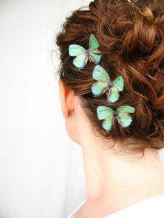 three handmade emerald green silk butterfly hair clips . emerald gypsies . pure dupioni silk. $17.00, via Etsy.