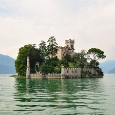 ~ ( Researching the Fantastical! www.EKaiserWrites...) ~ INCREDIBLE! I have GOT to see this someday! Loreto Island, Lake Iseo, Italy
