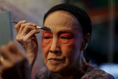 A Chinese opera actress applies make-up backstage before a performance in Chinatown in Bangkok, Feb. 17. (Jorge Silva/Reuters)