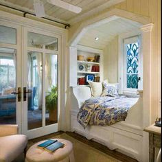 Ive always wanted a place by a window to cuddle up with a pillow under a blanket with a cup of hot coca/coffee or wine and read while looking out =)