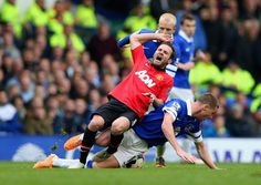 Juan Mata of Manchester United is tackled by James McCarthy.