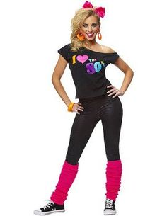 I Love The 80s Fancy Dress Costume for Ladies - pink hair bow, neon earrings, off-the-shoulder 80s T-shirt, plain black leggings, neon pink leg warmers and hi-top trainers.