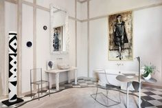 "Architects Daniel Suduca and Thierry Mérillou dedicated their ""muse's bathroom"" to the memory of French writer and singer Annabel Buffet, whose spiky-looking portrait by her husband, painter Bernard Buffet, adorns the wall over the footed bathtub. The classic, creamy decor includes elegant ceramic fixtures and a coiffeuse by Claude and François-Xavier Lalanne, as well as poetic accessories by ceramics artist Bela Silva and a collection of mirrors by British artist Marianna Kennedy."