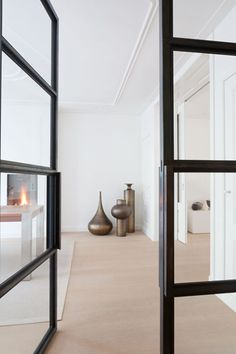 Contemporary townhouse interior by Dutch designer Remy Meijers featuring a trio of brass Beat Vessels by Tom Dixon. Cheap End Tables, Steel Doors And Windows, Townhouse Interior, French Style Homes, European Home Decor, Interior Decorating, Interior Design, Home Decor Furniture, Door Design
