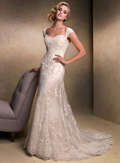 Emma Description With an eye to timeless romance, this slim A-line design features a delicate, sweetheart neckline and gorgeous beaded lace motifs dancing across tulle. Finished with corset back closure and available with detachable cap-sleeves.