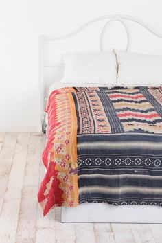 Love the white base room with tapestry coverlet. Awesome