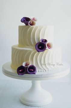 Something like this, but probably can't do the calla lillies (would be great if you could). Otherwise, replace them with darkish purple buttercream flowers. No pink! #weddingcakes