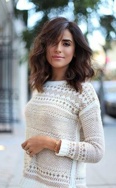 messy wavy brunette long bob with side part and long bangs