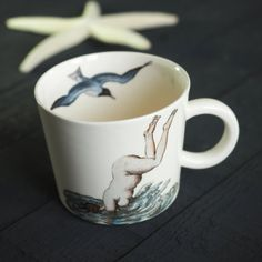 Art Cup, Mermaid Cup, Erotic Cup, Erotic Art Gift, Nude Art Mug, Female Nudity Gift, Seagull Cup, Bird Mug, Handmade Ceramics, Porcelain Cup  A jump in the sea mug  🍉 Our handmade porcelain made from all organic materials is a perfect way to enjoy a drink in a unique and nature-friendly way. An awesome gift for your beloved ones or for you (were not here to judge)  🍉 Size and dimensions: Volume: 350 ml/ 11.8 oz Bottom diameter: 8 cm/ 3.14 Upper diameter: 9 cm/ 3.5 Height: 8 c...