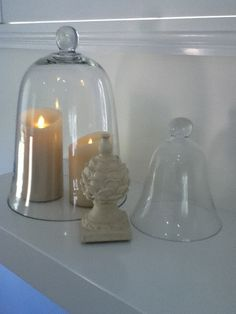 Love candles together with a cloche