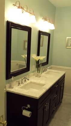 "dark vanities, ""Aquatic Edge"" by Valspar paint I know this is a bathroom, but I like the idea for a kitchen with some sort of blue stone for the backsplash"