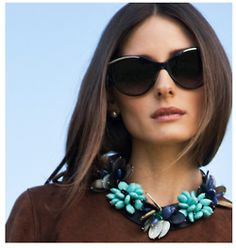 I think this works because her hair is so simple and her top so simple and the glasses add balance to the necklace.