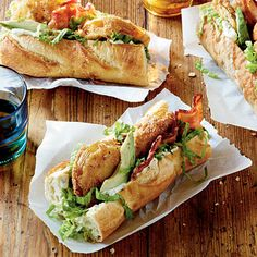 Fried Green Tomato Po'boys | Pile fried green tomatoes, lettuce, bacon and avocado on French bread baguettes and top with rémoulade sauce for a new take on a classic seafood sandwich.