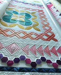 Amazing quilting that follows the shapes of the piecing.