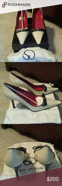 NIB St. John Patent Pumps 8.5 B Cream patent leather with black trim & leather bow with gold detailing. These are pure art!! Never worn & includes dust bag. One small transfer spot from being in the box. St. John Shoes Heels