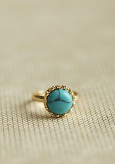 Turquoise Simplicity Ring 12.99 at shopruche.com. A lovely turquoise stone adorns this simple, adjustable gold-toned ring.0.5