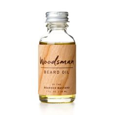 Woodsman Beard Oil – The Bearded Bastard. I (Martin) use this stuff regularly and noticed a definitive difference after two weeks of application. Softer and straighter beard hair. The smell is masculine, like a wood shop, but is subtle.