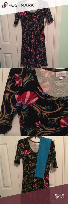 LuLaRoe Nicole NWT Beautiful LuLaRoe Nicole size Medium NWT. Perfect colors for year round! Matching leggings in separate listing. LuLaRoe Dresses
