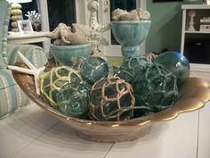 glass fishing floats in a bowl