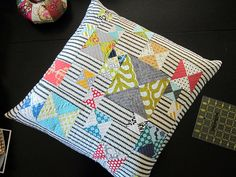quilted Hourglass pillow, not a tutorial but does show a picture of how she made the blocks first and then the sashing
