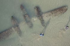Always thought this photo of the P-38 Lightning found on a beach in Wales in 2007 was cool (taken from a camera on a kite).  Photo credit: attributed to TIGHAR