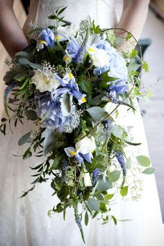 My bouquet had blue irises, white lisianthus, purple veronica, lavender hydrangea, seeded eucalyptus, dusty miller, and ivy.