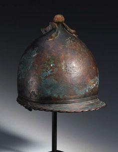 A BRONZE HELMET OF ETRUSCO-ITALIC TYPE  circa 1st century B.C.