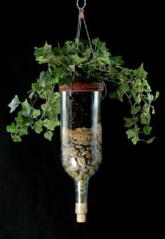 bottle hanging Planters, use coffee filter between layers so earth doesn't seep down and keeps a clean look.Wine bottle hanging Planters, use coffee filter between layers so earth doesn't seep down and keeps a clean look. Wine Bottle Planter, Recycled Wine Bottles, Wine Bottle Art, Wine Bottle Garden, Bottle Terrarium, Recycled Glass, Bottle Cutting, Glass Bottle Crafts, Wine Craft