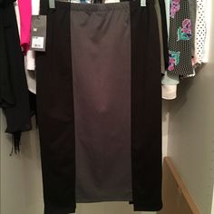NWT black and grey pencil skirt NWT black and gray pencil skirt. Purchased from target. Never worn. No trades. Please use offer feature. If no modeling shot included in listing, it does not fit, please don't request one 😁 Mossimo Supply Co. Skirts
