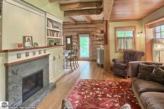 You, too, can enjoy the Torch Lake home's five fireplaces, its nearly four acres of ground...